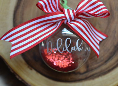 Personalized Christmas Ornament - Glitter filled and tied with ribbon.