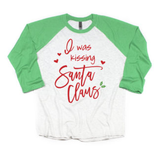 I was kissing Santa Claus shirt. Getting matching shirts for Mommy and mini. 3/4 sleeve raglan shirts with your choice of red, green or black sleeves.