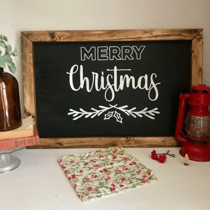 Merry Christmas hand painted sign. White lettering on black with a frame.